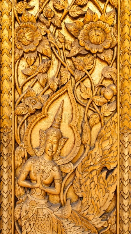 Ancient art pattern on the wooden carvings door in Thai temple in Thai temple in the North of Thailand stock photo