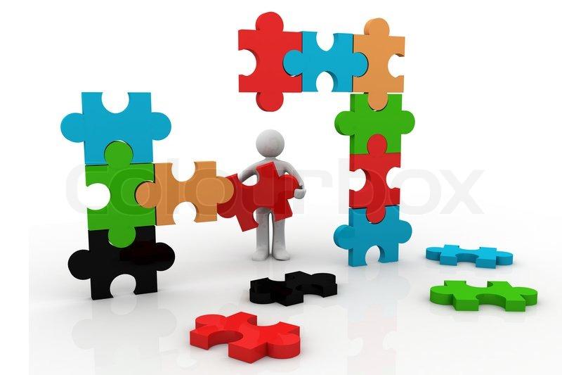 3d Man Building A Puzzle Stock Photo