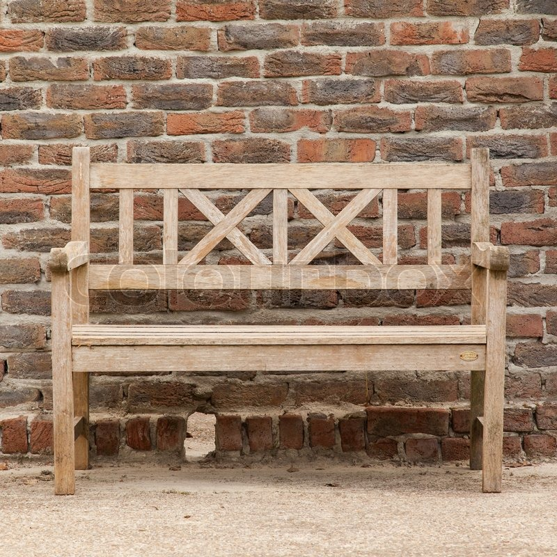 Country Wooden Benches Part - 29: Rugged, Primitive Wooden Sidewalk Bench Beside Multi-colored Very Old Brick  Wall | Stock Photo | Colourbox