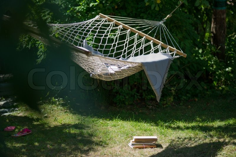 hammock in the garden with books pillow and blanket  out of office for summer vacation  relaxing with books in the hammock    stock photo   colourbox hammock in the garden with books pillow and blanket  out of      rh   colourbox