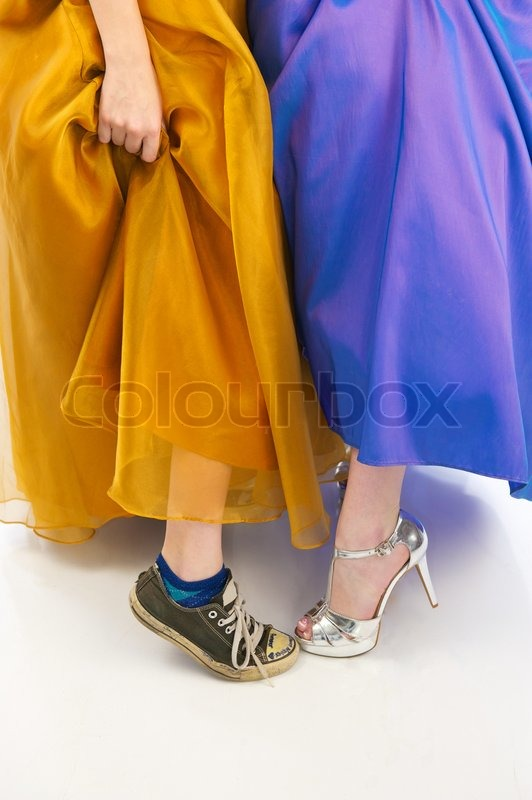 sneakers and high heels in prom dresses stock photo