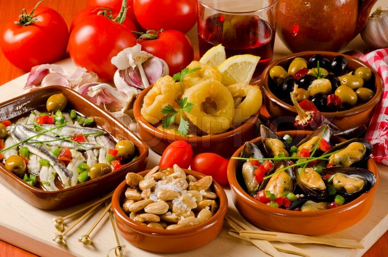 Spanish cuisine. Assortment of Tapas including Serrano Ham Marinated Olives Mussels in Sauce and others served with red wine stock photo & Spanish cuisine. Assortment of Tapas including Serrano Ham ...