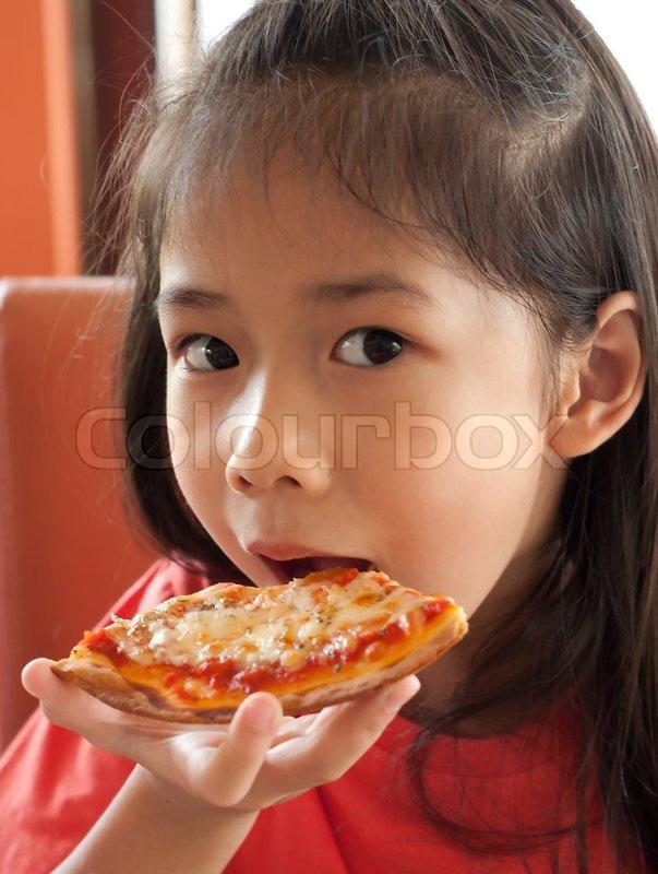 little asian girl enjoy eating pizza