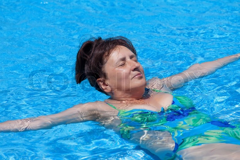 Middle Aged Woman Swims In The Swimming Pool Stock Photo Colourbox