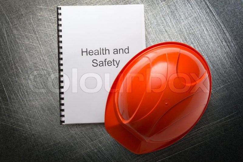 Health and safety register with helmet, stock photo
