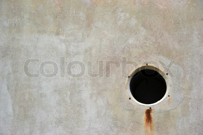 A vent hole in the wall of an industrial building, stock photo