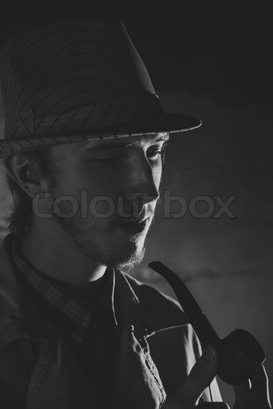 Black and white old-fashioned portrait of smiling man with cigar, stock photo