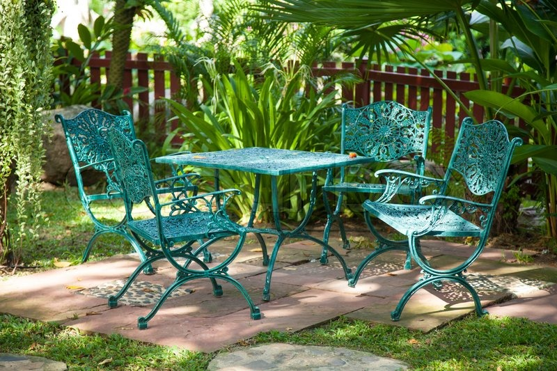 Chairs and tables, located in the garden made from metal to sit in the garden, stock photo