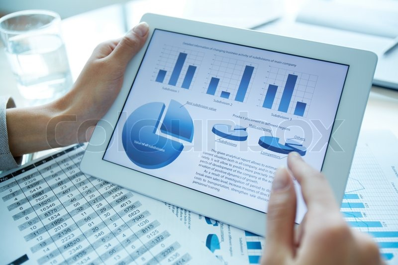 Stock image of 'Close-up of a financial analyzer holding a digital tablet with statistical data'