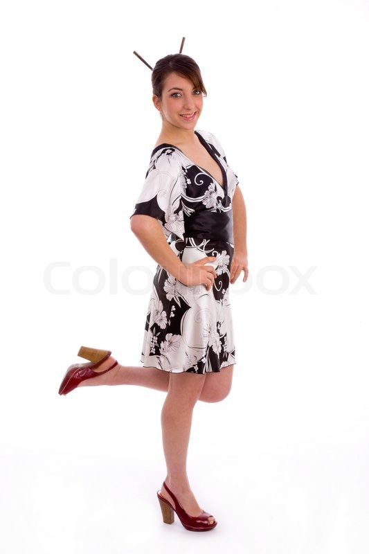 Full Body Pose Of Smiling Young Female Stock Photo