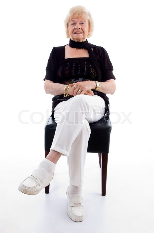 Grandmother Sitting On Chair Stock Photo Colourbox