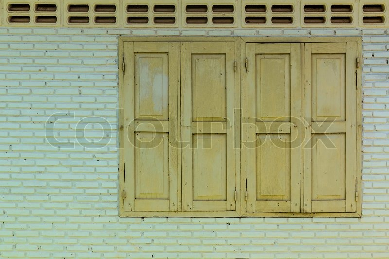 Green wooden window with green wall, stock photo