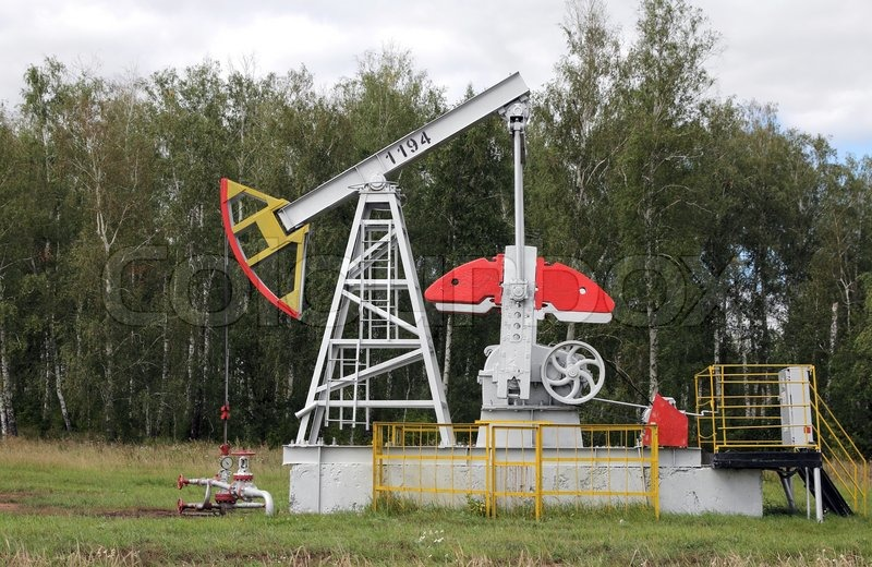 Oil pumpjack Oil industry equipment - Stock Photo - Colourbox