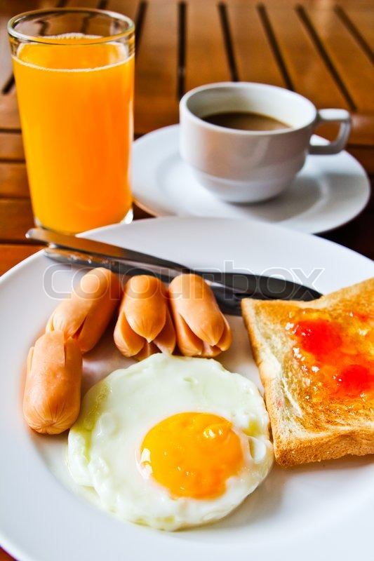 coffee and egg breakfast with fried eggssausage toasts juice and coffee