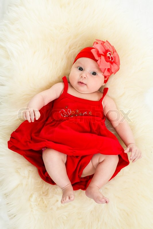 85c2e376d Top view of beautiful baby in red dress