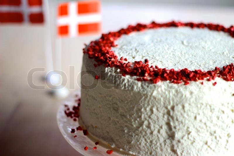 Red And White Birthday Cake And The Danish Flag In The Background