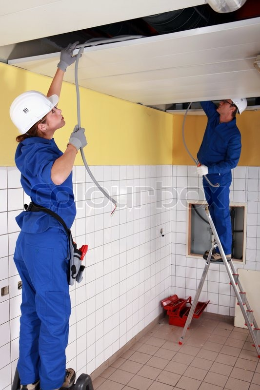 Electrician wiring a building | Stock Photo | Colourbox