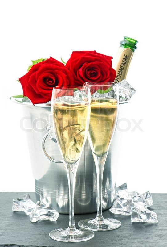 Two Glasses Bottle Of Champagne And Red Roses Stock