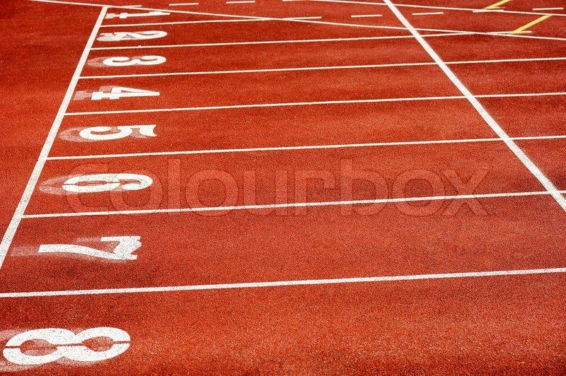 Eight runner tracks in a sport stadium, stock photo