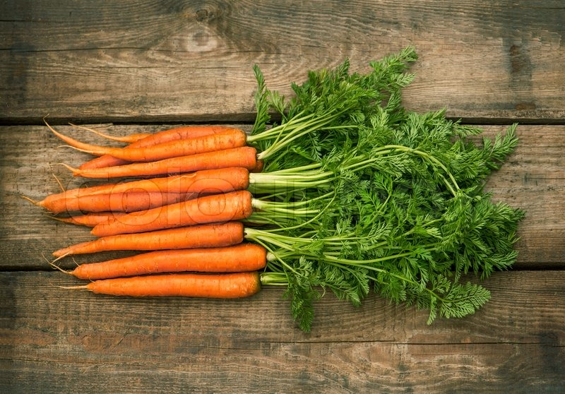 Roots of fresh carrots organic raw food ingredients stock photo roots of fresh carrots organic raw food ingredients stock photo colourbox forumfinder Image collections