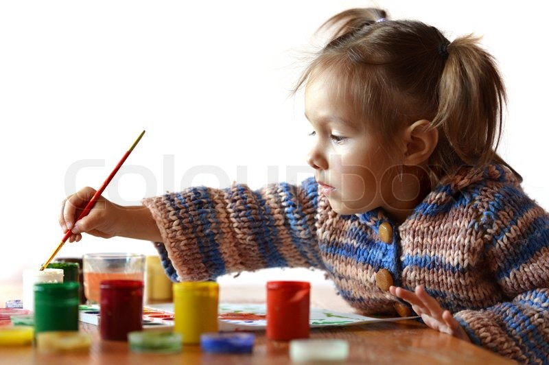 Cute baby draws paint in the room, stock photo