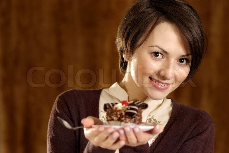 Portrait of a nice woman with a cake in hand, stock photo