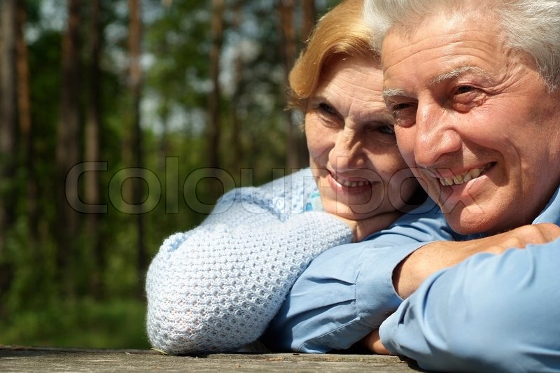 Beautiful old people went for a walk on the nature, stock photo