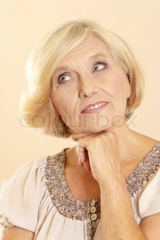 Portrait Of A Beautiful Mature Woman On A Light Background -1041