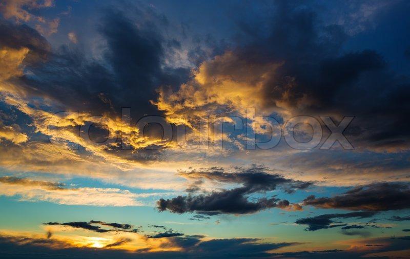 Beautiful thunderstorm cloud at sunset, stock photo