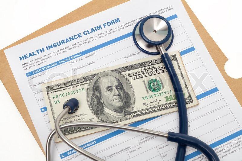 Medical reimbursement with health insurance claim form and stethoscope on cash isolated, stock photo