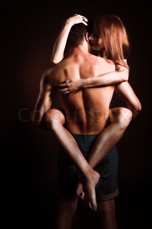 Stock image of 'Passionate embraces men and women'