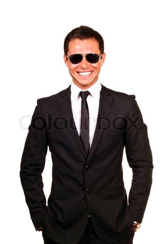 0ffe264f63e175 Stock Bild von  Young professional lächelnd mit Sonnenbrille auf einem weißen  Hintergrund