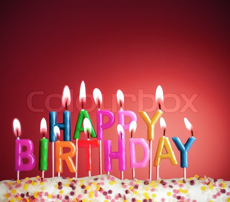 happy birthday lit candles on red background stock photo colourbox