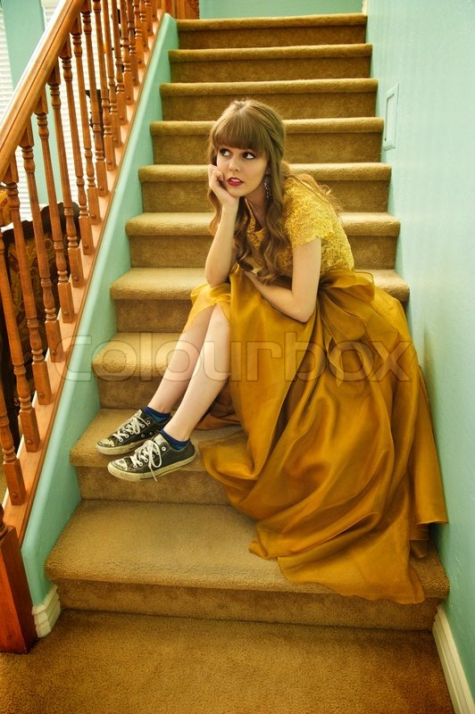 Teen Girl With Formal Abendkleid und Sneakers | Stockfoto | Colourbox