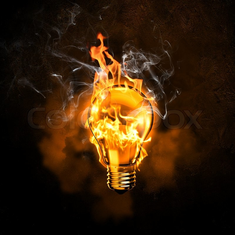Image Of Electric Bulb In Fire Flames Against Black