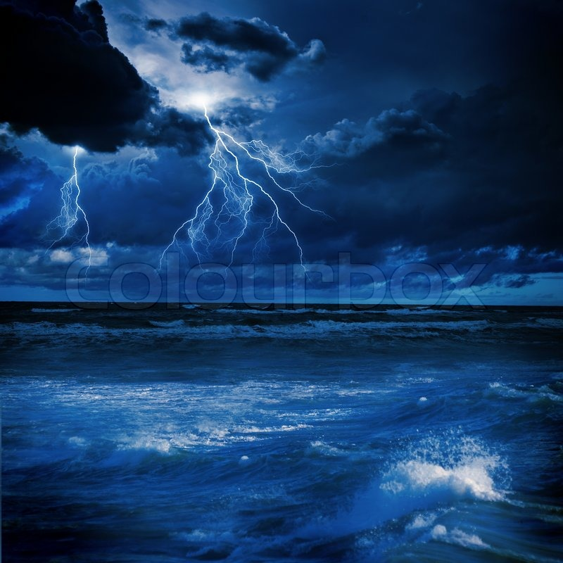 Image of night stormy sea with big waves and lightning, stock photo