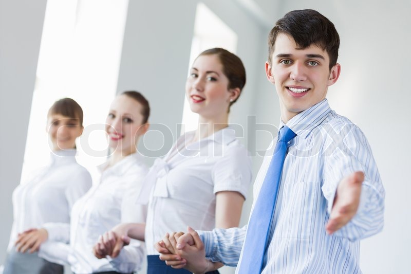 Stock image of 'Businessteam holding hands'