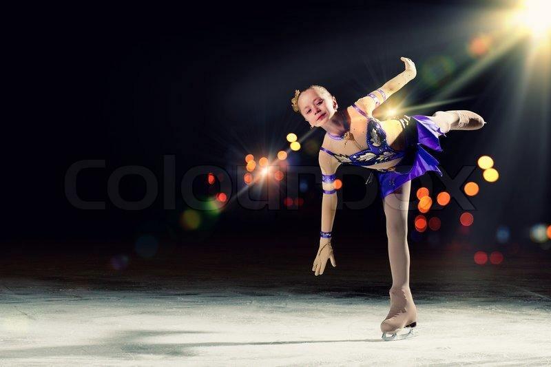 Little Girl Figure Skating At Sports Arena Stock Photo