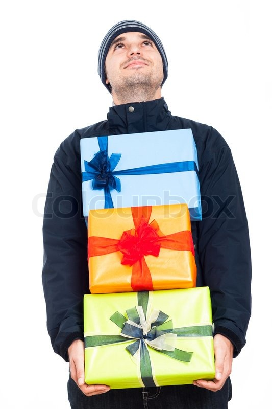 Happy man in winter jacket holding Christmas gift boxes and looking up isolated on white background stock photo  sc 1 st  Colourbox & Happy man in winter jacket holding ...   Stock Photo   Colourbox
