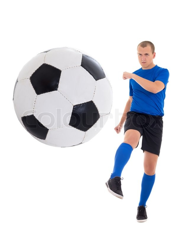 young soccer player in blue kicking ball isolated on white background