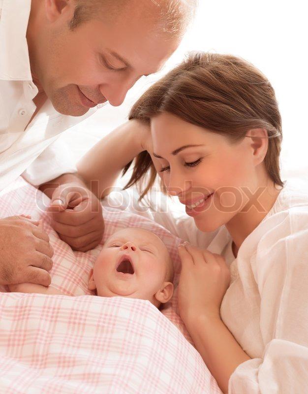 Newborn Baby Awake Parents Looking On Stock Photo Colourbox