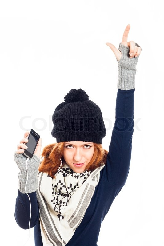 8b826bff9ad Winter woman with smartphone pointing ...