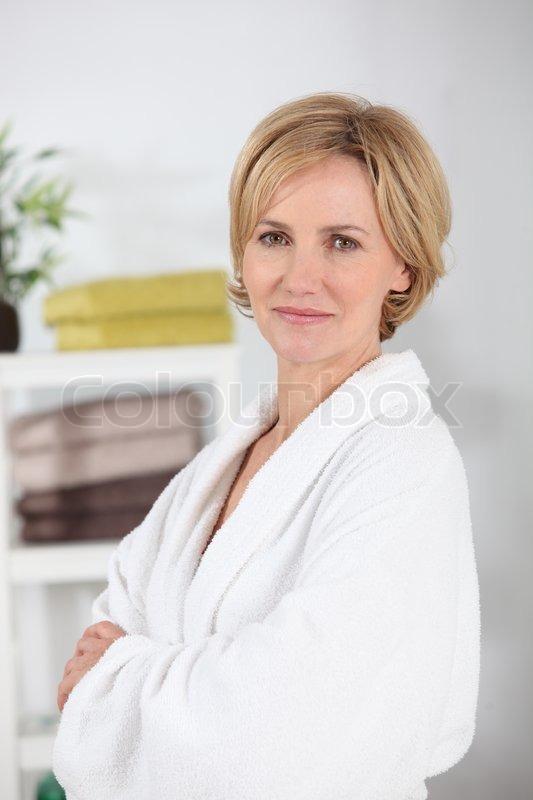 Woman wearing a white toweling bathrobe  7b285b531