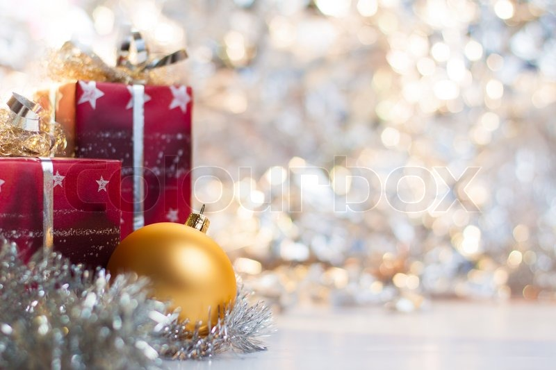 Christmas ball and gifts on abstract light background, stock photo