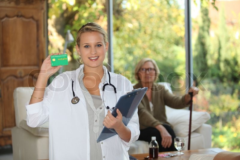 A nurse visiting an elderly patient at home, stock photo