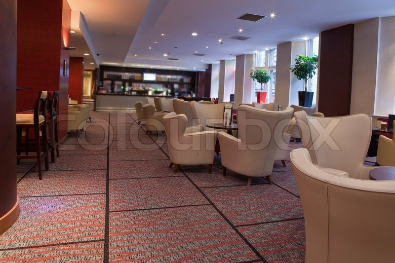 Hotel\'s bar with chairs and tables to sit and relax, stock photo