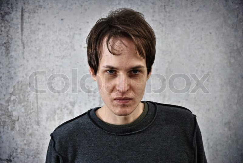 Crazy young man with the face of evil, stock photo
