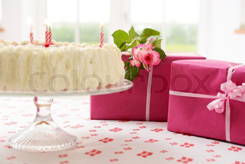 Birthday Cake And Presents On A Table