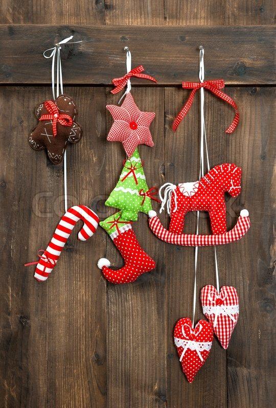 Christmas decoration handmade toys hanging over rustic wooden background. nostalgic retro style picture, stock photo