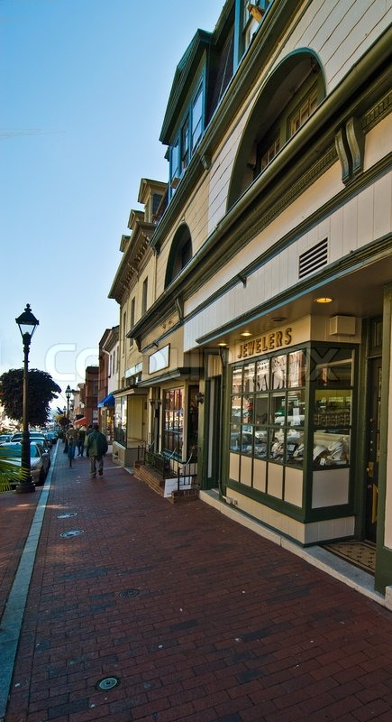 Typical New England or Midwest downtown main street. This could be any small town U.S.A. Old buildings turned into small businesses, retail shops and cafe\'s. , stock photo